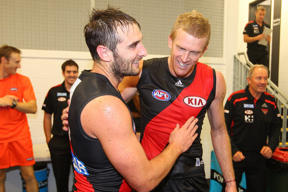 Jobe Watson and Dustin Fletcher